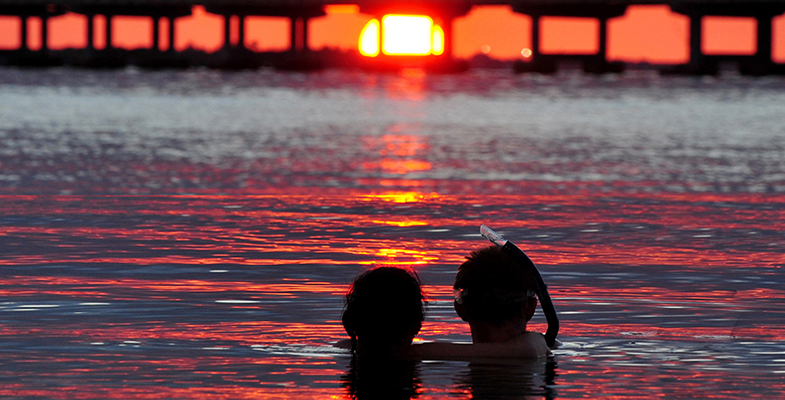 florida keys key west ROB O'NEAL/The Citizen A young couple pauses Sunday as the sunsets behind the Bahia Honda Bridge. silhouette ocean honeymoon married